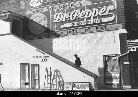Man Ascending Stairs to 'Colored' Entrance of Crescent Theater, Belzoni, Mississippi, USA, Marion Post Wolcott, Farm Security Administration, October 1939 - Stock Photo