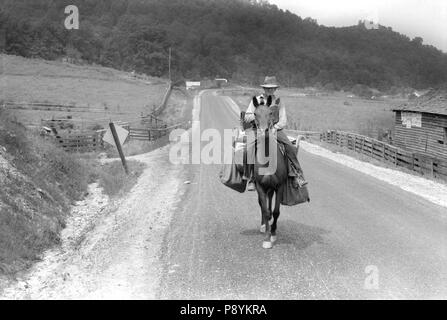 Rural Postman Delivering Mail on Horse, Jackson, Kentucky, USA, Marion Post Wolcott, Farm Security Administration, July 1940 - Stock Photo