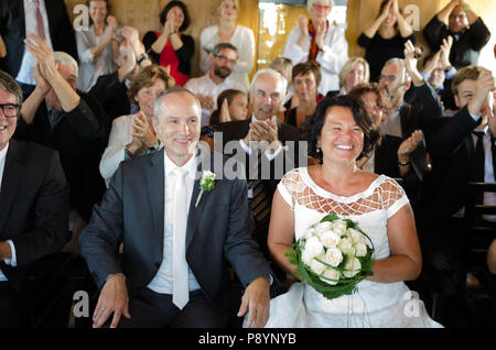 Old aged bride and groom getting married, wedding ceremony old aged bride and bridegroom - Stock Photo