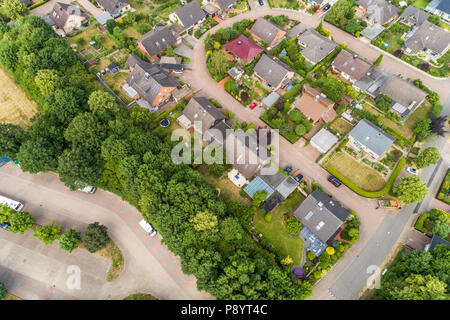 Aerial view of a suburb with detached houses, semi-detached houses and terraced houses with small front gardens and green lawns in northern Germany, t - Stock Photo
