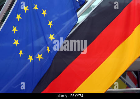 Reischach, Italy, flag of the European Union and national flag of the Federal Republic of Germany - Stock Photo