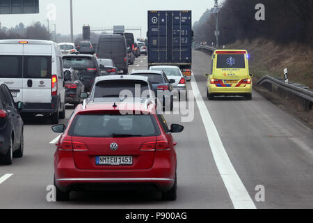 Nuernberg, Germany, Dutch ambulance drives on the traffic lane of the A9 past a traffic jam - Stock Photo