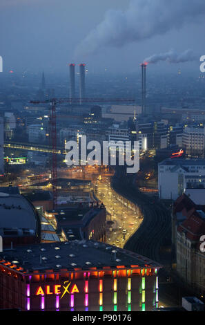 Berlin, Germany, Smoking chimneys of the cogeneration plant Berlin-Mitte at night - Stock Photo