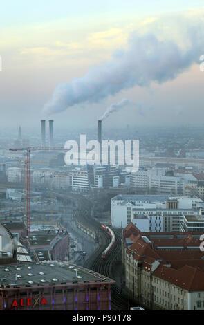 Berlin, Germany, smoking chimneys of the cogeneration plant Berlin-Mitte - Stock Photo