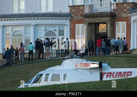 US President Donald Trump greets hotel guests after arriving at the Trump Turnberry resort in South Ayrshire, where he is expected to stay over the weekend. - Stock Photo