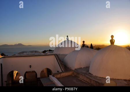 Pittoresque Mosque of Sidi Bou Said at Sunset overviewing the Gulf of Tunis - Stock Photo