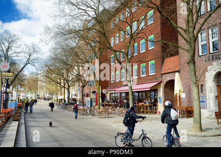 BREMEN, GERMANY - MARCH 23, 2016: Embarktment of Weser river in Bremen is very popular among tourists. Many shops and restaurants can be found there. - Stock Photo