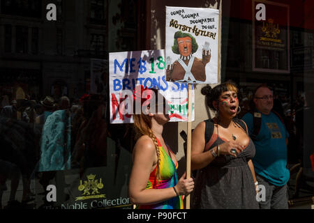 Protesters against the visit of US President Donald Trump to the UK, march through central London, on 13th July 2018, in London, England. - Stock Photo