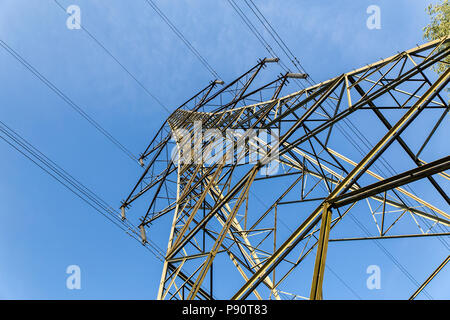 Power Transmission Tower or Electricity Pylon carrying High Voltage power lines overhead.   This structure is used throughout England, Great Britain a - Stock Photo
