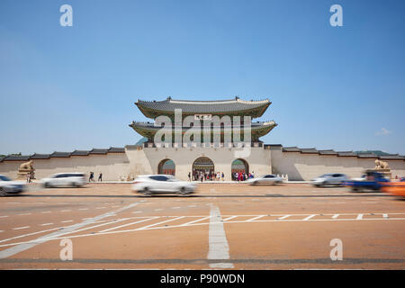 Motion blurred traffic at the entrance to Gyeonghoeru Palace in Seoul, South Korea. - Stock Photo