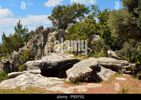 Stones marking entrance to underground shelters at ruined Hydas castle above Turgut village near Marmaris resort town in Turkey. - Stock Photo
