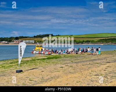 26 June 2018: Rock, Cornwall, UK - Queue of people waiting for the ferry to Padstow. - Stock Photo