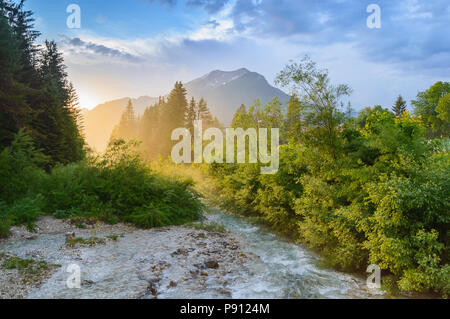 Mountain stream at sunset. River view in Alps near Ehrwald, Tyrol, Austria - Stock Photo