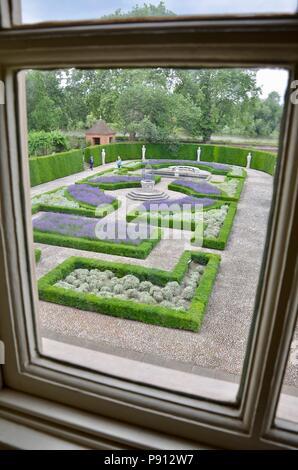 View through window into the Queen's Garden, Kew Palace, Royal Botanic Gardens Kew, Richmond, London, England, UK. - Stock Photo