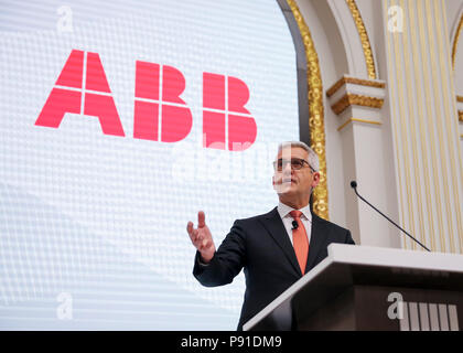 New York, USA. 13th July, 2018. Ulrich Spiesshofer, chief executive officer of ABB Group, speaks before ringing the closing bell at the New York Stock Exchange in New York, the United States, July 13, 2018. The President of Swiss industrial technology giant ABB Group said Friday that the company greatly values the Chinese market at a time when China is pushing forward its reform and opening-up policy. Credit: Wang Ying/Xinhua/Alamy Live News - Stock Photo