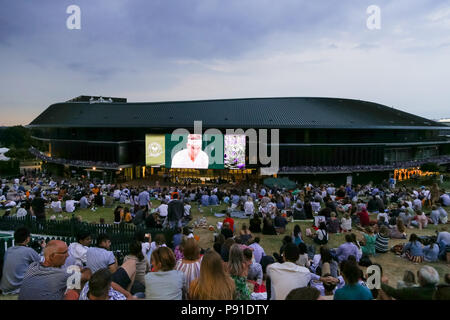 London, UK. 13th July, 2018. Fans Tennis : Fans are watching a match through a TV screen at Aorangi Terrace during the Men's singles semi-final match of the Wimbledon Lawn Tennis Championships between Novak Djokovic of Serbia and Rafael Nadal of Spain at the All England Lawn Tennis and Croquet Club in London, England . Credit: AFLO/Alamy Live News - Stock Photo