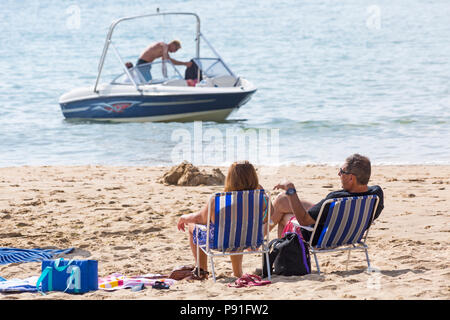 Bournemouth, Dorset, UK. 14th July 2018. UK weather: The heatwave continues with another hot sunny day, as sunseekers make the most of the glorious weather and head to the seaside at Bournemouth beaches. Credit: Carolyn Jenkins/Alamy Live News - Stock Photo