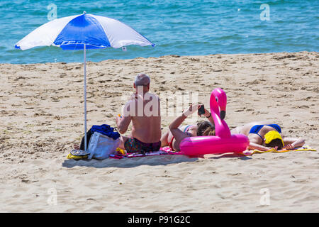 Bournemouth, Dorset, UK. 14th July 2018. UK weather: The heatwave continues with another hot sunny day, as sunseekers make the most of the glorious weather and head to the seaside at Bournemouth beaches. Sunbathers on the beach. Credit: Carolyn Jenkins/Alamy Live News - Stock Photo