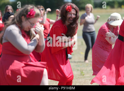 Dublin, Ireland. 14th July 2018. Participants in this year's Wuthering Heights Day rehearse their dance to Kate Bush's iconic song and video of 'Wuthering Heights' at St Anne's Park in Dublin, Ireland.  Credit : Laura Hutton/Alamy Live News. - Stock Photo