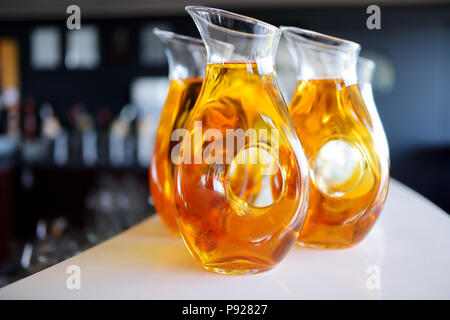 Jugs full of refreshing drink on party, wedding or festive event - Stock Photo