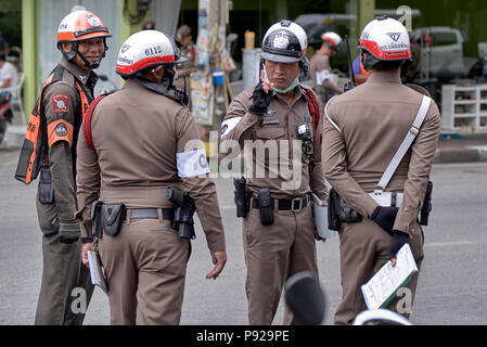 Thailand police with senior officer giving instructions - Stock Photo