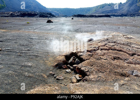 Steaming vents on the Kilauea Iki volcano crater surface with crumbling lava rocks in Volcanoes National Park in Big Island of Hawaii, USA - Stock Photo