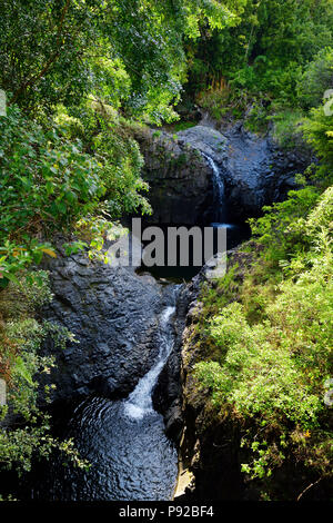 Two waterfalls and water puddle along the Pipiwai Trail in the Haleakala National Park, Maui, Hawaii, USA - Stock Photo