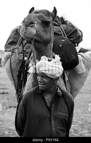 A  CAMEL MAN leads tours in the THAR DESERT near JAISALMER - RAJASTHAN, INDIA -MR - Stock Photo