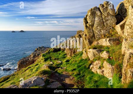 Scenic rugged Cornish coastline at Porth Nanven on sunny evening, Cornwall, England - Stock Photo
