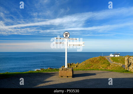 Distance signpost at Land's End, Penwith Peninsula, Cornwall, England, most westerly point of England. - Stock Photo
