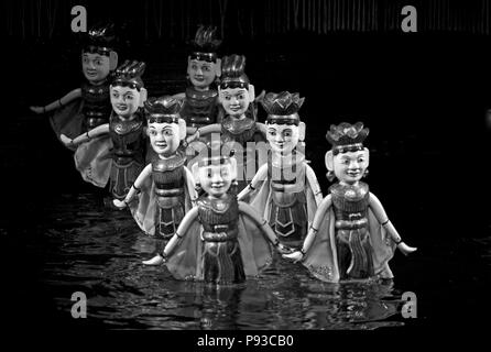 Dancing women during the performance at the THANG LONG WATER PUPPET THEATRE - HANOI, VIETNAM - Stock Photo