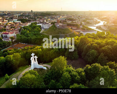 Aerial view of the Three Crosses monument overlooking Vilnius Old Town on sunset. Vilnius landscape from the Hill of Three Crosses, located in Kalnai  - Stock Photo