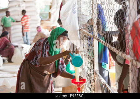 Kakuma, Kenya - Food distribution by the humanitarian aid organization World Food Program in a secure warehouse in the Kakuma refugee camp. - Stock Photo
