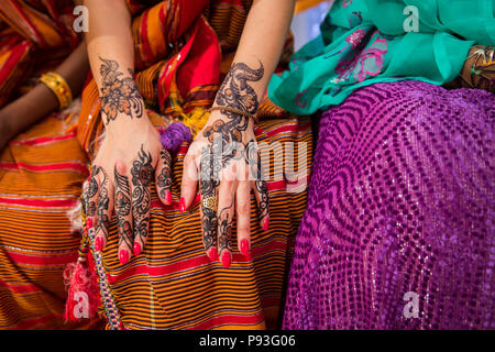 Black and Brown Henna Hands Drawings on Women for African Wedding Ceremony - Stock Photo