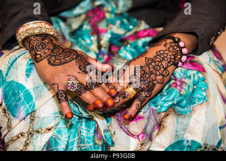 Black and Brown Henna Hands Drawings on Women for African Wedding Ceremony with Big Rings - Stock Photo