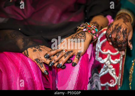 Black Henna Hands Drawings on Women for African Wedding Ceremony with Big Rings - Stock Photo