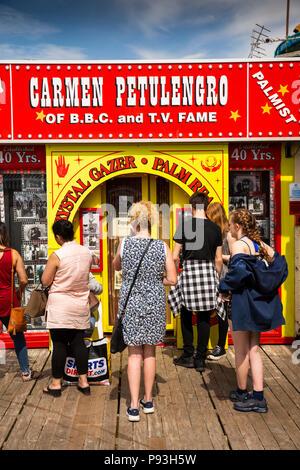 UK, England, Lancashire, Blackpool, South Pier, visitors queueing outside Carmen Petulengro Palmist and Clairvoyant - Stock Photo