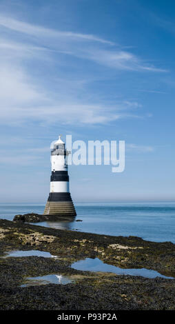 The Grade II listed Trwyn Du Lighthouse on the Anglesey coast between Black Point near Penmon and Ynys Seriol (Puffin Island), Wales, UK - Stock Photo