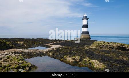 Grade II listed Trwyn Du Lighthouse on the Anglesey coast between Black Point near Penmon and Ynys Seriol (Puffin Island), Gwynedd, Wales, UK - Stock Photo