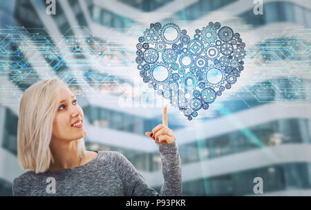 Portrait of smiling woman pointing finger up showing a gear heart hologram. Future technology artificial intelligence health protection. Human charact - Stock Photo