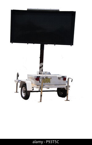 Blank white electronic warning information sign on wheels with black face - Stock Photo