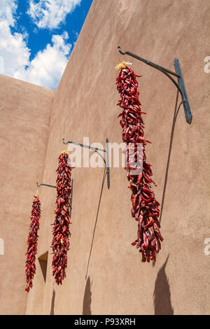 New Mexico, Santa Fe Community Convention Center, exterior, chile pepper ristras - Stock Photo