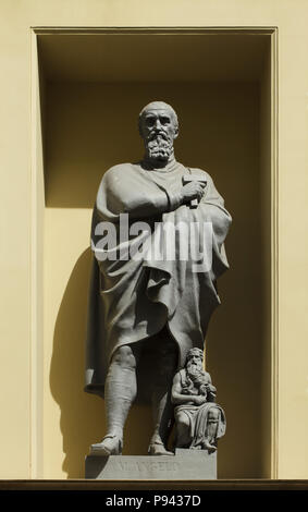 Italian Renaissance sculptor Michelangelo Buonarroti. Statue on the facade of the building of the New Hermitage designed by German Neoclassical architect Leo von Klenze in Saint Petersburg, Russia. - Stock Photo