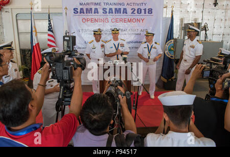 180709-N-OU129-235 SAN FERNANDO CITY, Philippines (July 9, 2018) Rear Adm. Joey Tynch, Commander, Task Force 73, answers questions from members of the media during the opening ceremony of Maritime Training Activity (MTA) Sama Sama 2018. The week-long engagement focuses on the full spectrum of naval capabilities and is designed to strengthen the close partnership between both navies while cooperatively ensuring maritime security, stability and prosperity. (U.S. Navy photo by Mass Communication Specialist 2nd Class Joshua Fulton/Released) - Stock Photo