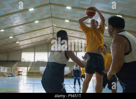 180709-N-OU129-703 SAN FERNANDO CITY, Philippines (July 9, 2018) U.S. Navy sailors play basketball with Philippine Navy sailors at St. Louis College as a part of Maritime Training Activity (MTA) Sama Sama 2018. The week-long engagement focuses on the full spectrum of naval capabilities and is designed to strengthen the close partnership between both navies while cooperatively ensuring maritime security, stability and prosperity. (U.S. Navy photo by Mass Communication Specialist 2nd Class Joshua Fulton/Released) - Stock Photo