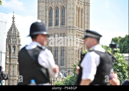 Police on duty during the trump protests in london - Stock Photo