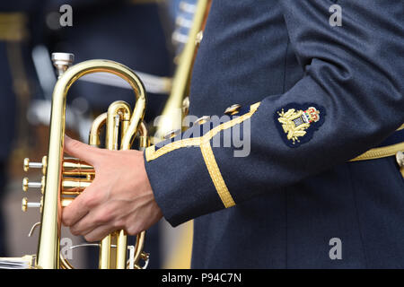 Members of the Royal Air Force (RAF) Band perform for a crowd of distinguished visitors during the 2018 Royal International Air Tattoo (RIAT) at RAF Fairford, United Kingdom (UK) on July 13, 2018. This year's RIAT celebrated the 100th anniversary of the RAF and highlighted the United States' ever-strong alliance with the UK. - Stock Photo