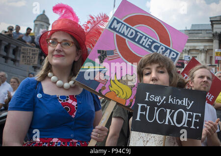 Women hold their handmade placards at the Carnival of Resistance, the anti-Trump protest organised in London, UK on the 13th July 2018. - Stock Photo