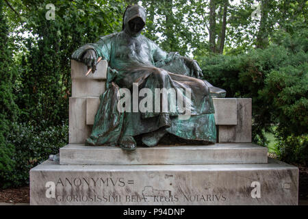 Anonymus, the faceless chronicler of King Bela, was the first medieval Hungarian chronicler. This bronze statue is the work of the contemporary sculptor Miklós Ligeti and is located near Vajdahunyad Castle in Budapest, Hungary. - Stock Photo