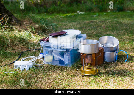 Camping equipment on a campsite - Stock Photo